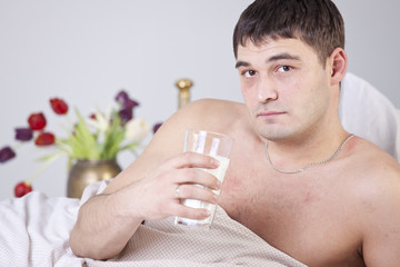 Sick man with glass milk