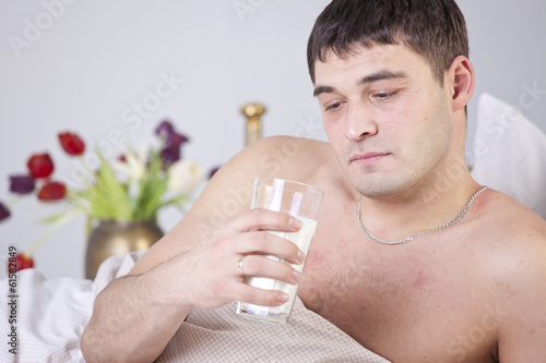 Unhappy man with glass milk