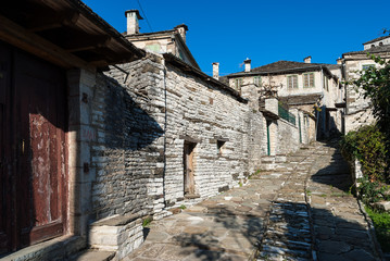 Street and houses in a traditional village of Epirus, Greece