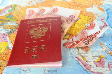 Russian international passport with money within and origami pla