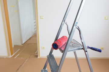 Ladder and red roller, home renovation