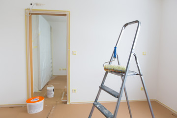 Ladder, roller and buckets, home renovation