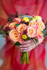 Woman hands holding flower bouquet