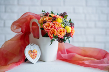 Still life with beautiful flower bouquet and photo frame