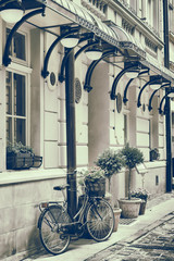 Vintage stylized photo of Old bicycle outdoors