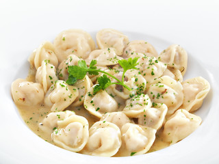 Traditional Russian dumplings with meet or cheese served with pa