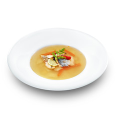 Hot tasty healthy soup with fish and vegetables served on a whit