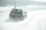 Car driving in snow storm