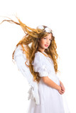 Angel girl on white with flowers crown and feather wings
