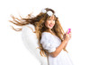 Angel blond girl with mobile phone and feather wings on white