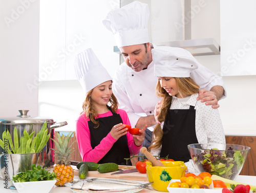 Chef master and junior pupil kid girls at cooking school