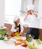 Funny chef master and junior kid girl at cooking school crazy