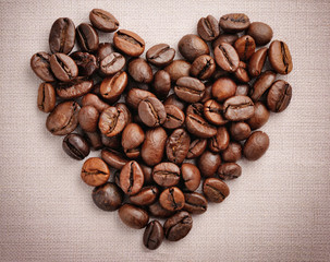 Heart from coffee beans on a linen cloth