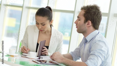 businessman and businesswoman exchanging contacts