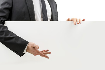 Businessman gesturing to a blank white board