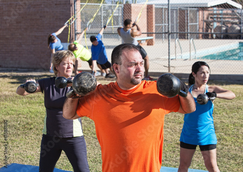 Three Adults Exercising Outdoors