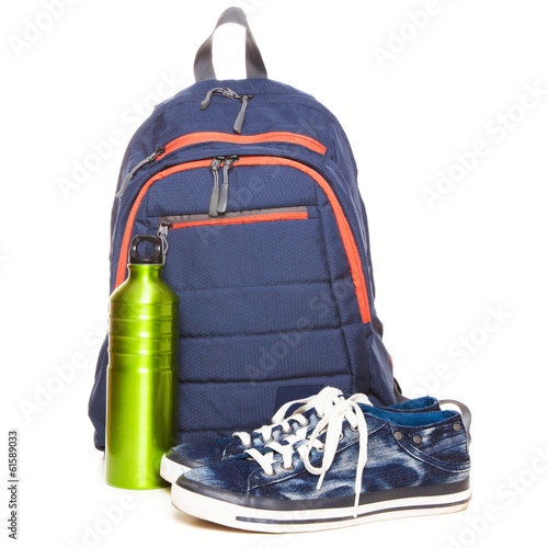 Backpack and sneakers on white background