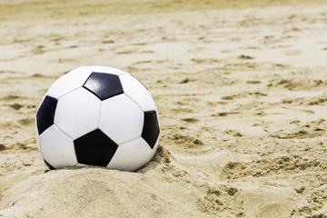 Soccer ball on the sand