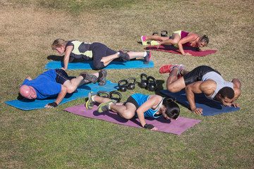 Group Doing Knee Elbow Exercises