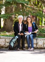 Professor helping Senior Student