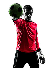caucasian soccer player goalkeeper man  stopping ball one hand s