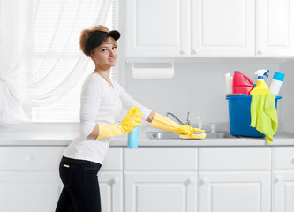 woman with cleaning stuff clean kitchen