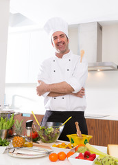 Chef male portrait on white countertop at kitchen