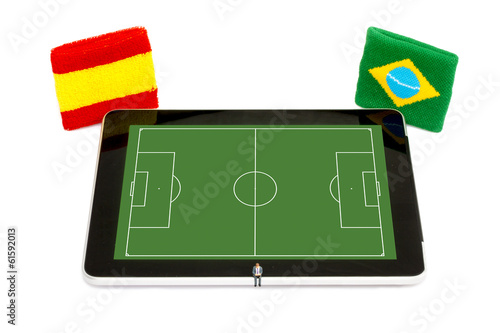 man booking Soccer event on Digital Tablet - Spain vs Brazil