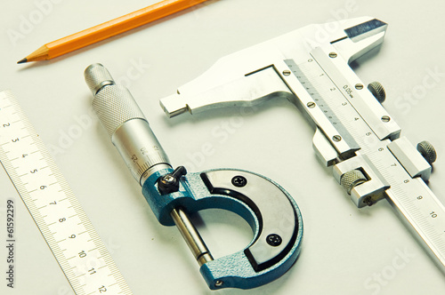 measuring instruments, pencil on white sheet