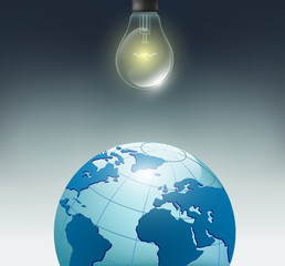 incandescent bulb and planet earth on a dark background