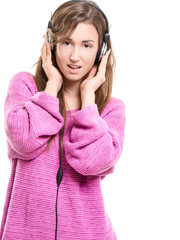Woman listening to music from headphones
