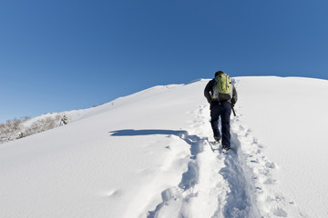 Man hiking in the snow