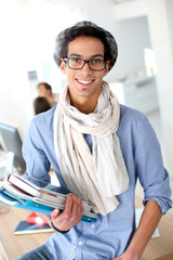 Portrait of smiling student holding books