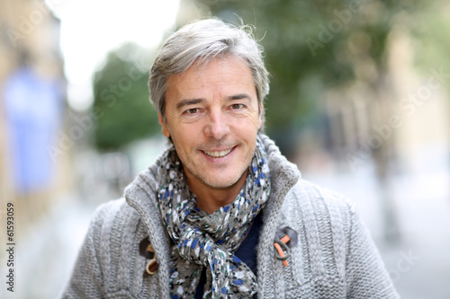 Portrait of attractive mature man in town