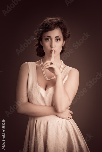 Vintage inspired image of woman having a secret