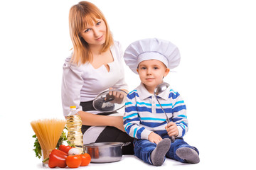 happy mom and baby are cooking on the kitchen. isolated