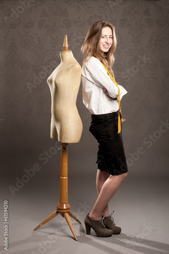 young woman with old mannequin