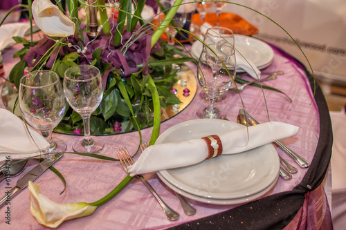 Table set for guests decorated with flowers
