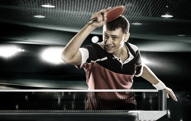 sports man tennis-player on black background