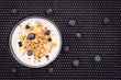Top view of muesli with yogurt and fresh blueberries. background