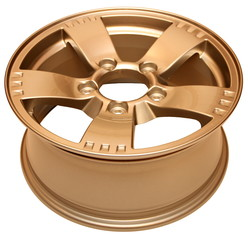 Isolated modern gold aluminum alloy wheel on a white background