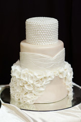 White wedding cake decorated with white pearls