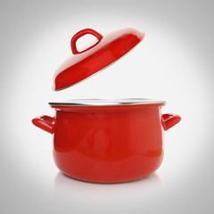 Red cooking pot on grey background