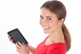 Cheerful woman using electronic tablet.