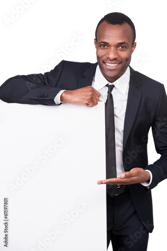 Businessman pointing a copy space.