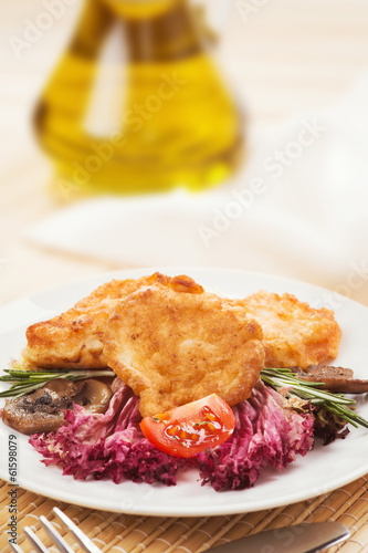 Healthy food, fish in batter with vegetables