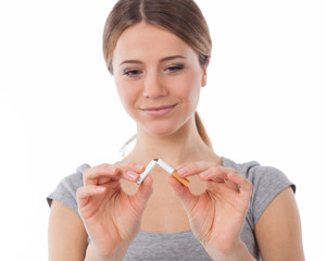 Woman breaking a cigarette (focus on cigarette)