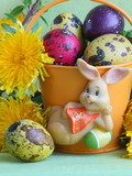 Easter bunny , eggs and flowers - green holiday background