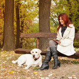 Beautiful woman and his dog (Labrador retriever) relaxing