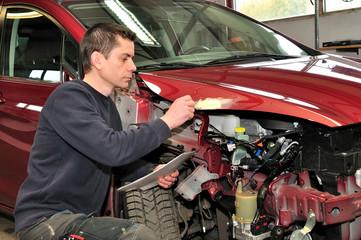 Checking car damage.